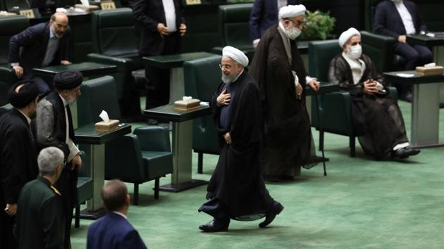 Iranian President Hassan Rouhani walks after delivering a speech on the opening ceremony of Iran's 11th parliament, as the spread of the coronavirus disease.(VIA REUTERS)