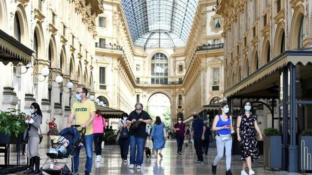 FILE PHOTO: People walk at at Galleria Vittorio Emanuele II, as Italy eases some of the lockdown measures put in place during the coronavirus disease (COVID-19) outbreak, in Milan, Italy May 18, 2020. REUTERS/Flavio Lo Scalzo/File Photo(REUTERS)