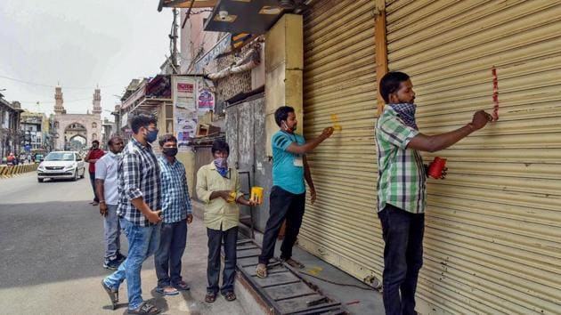 Hyderabad: GHMC officials put marks on shops after Telangana government permitted shopkeepers to open their establishments on odd-even basis, during the ongoing COVID-19 lockdown, at Charminar in Hyderabad, Tuesday, May 19, 2020. (PTI Photo) (PTI19-05-2020_000192A)(PTI photo)