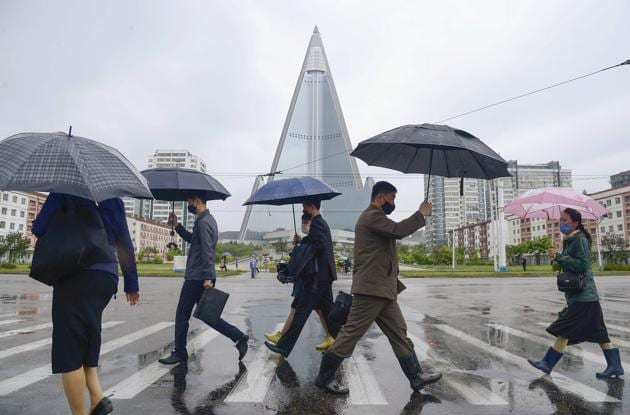 People wearing protective face masks walk amid concerns over the new coronavirus disease (COVID-19) in Pyongyang, North Korea.(REUTERS)