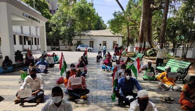 Tribals stage sit-in protest seeking new ration cards in Palghar.(HT Photo)