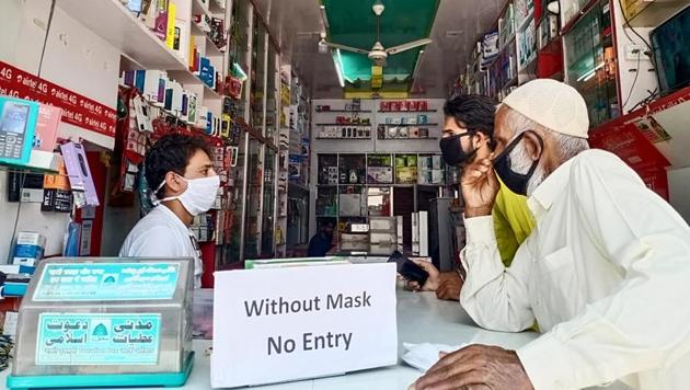 A shopkeeper from Mendhar area of Poonch district following the preventive measures against Covid-19 and barring entry of customers without face masks.(ANI File Photo)