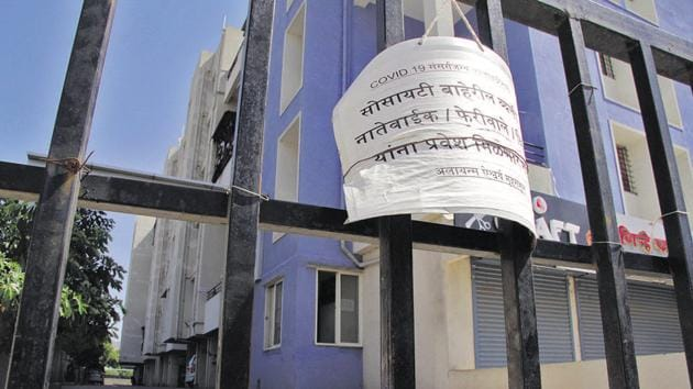 With stranded residents returning to Pune from various places, housing societies are worried and seeking a NOC from them. On Tuesday, a notice barring the entry of outsiders was spotted at a society gate in Narhe.(Ravindra Joshi/HT PHOTO)