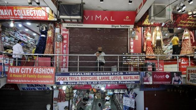 Shops open for business after relaxation in lockdown restrictions, at Sector 27 market, in Noida.(Sunil Ghosh / Hindustan Times)