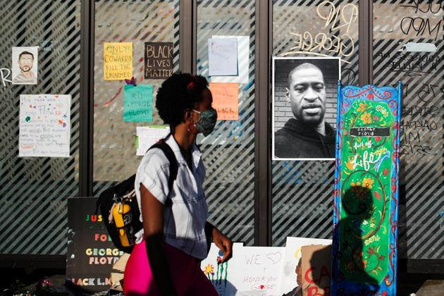 A picture of African-American man George Floyd is seen at a makeshift memorial put up by protesters at the corner where he got arrested, in the aftermath of a white police officer getting caught on a bystander's video pressing his knee into Floyd's neck, who later died at a hospital, in Minneapolis, Minnesota, US.(REUTERS)