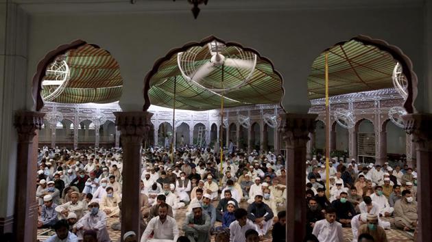 Muslims offer Eid al-Fitr prayers at a mosque in Peshawar, Pakistan, on Sunday.(AP Photo)