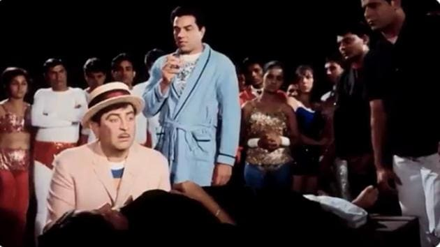 Raj Kapoor and Dharmendra in a scene from Mera Naam Joker.