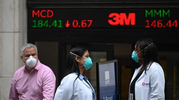 US stocks pared losses after Trump's remarks and oil gained on hopes the dispute will not curb the economy's nascent recovery from the coronavirus pandemic.(AFP file photo)