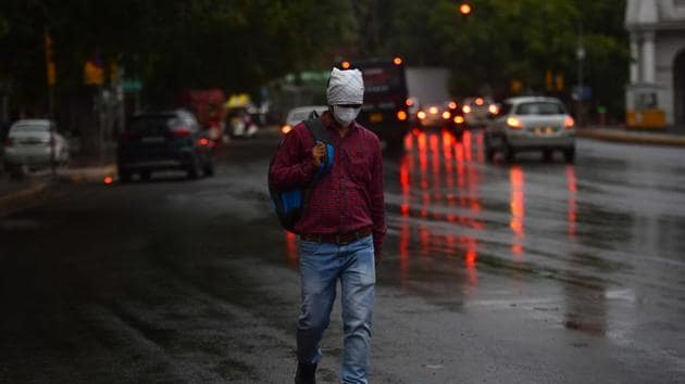 New Delhi, India - May 29, 2020: Commuters seen on road amid rainfall, in Connaught Place, New Delhi, India, on Friday, May 29, 2020. (Photo by Sanchit Khanna/ Hindustan Times)(Sanchit Khanna/HT PHOTO)