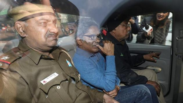 Rajiv Saxena (centre) was deported to India from the UAE on January 31, 2019, and arrested under money laundering act.(Reuters file photo)