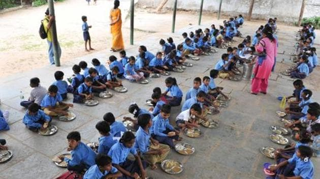 Children being served mid-day meals at a government school.(HT FILE PHOTO)