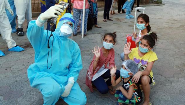 A doctor takes a selfie with children who were infected with Covid-19 before they are discharged following their recovery from the coronavirus disease at the Aurbindo hospital in Indore.(ANI File Photo)