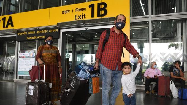Passengers exit on their arrival at Netaji Subhas Chandra Bose International (NSCBI) Airport, in Kolkata, India on Thursday, May 28, 2020. (Photo by )(Samir Jana / Hindustan Times)
