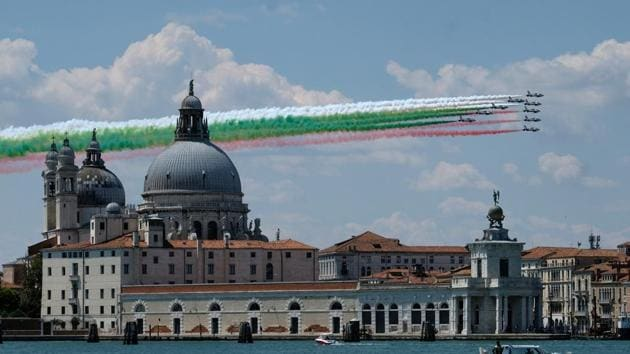 """The aerobatic demonstration team of the Italian Air Force, the Frecce Tricolori (""""Tricolor Arrows""""), fly over the Basilica of Saint Mary of Health as they perform as part of a nationwide tour to show unity and solidarity following the outbreak of the coronavirus disease (COVID-19), in Venice, Italy.(REUTERS)"""