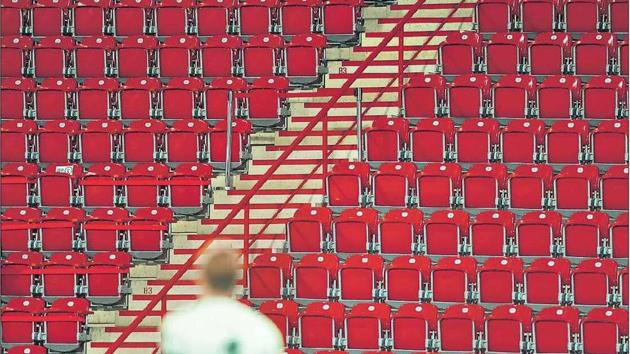 A stadium without fans is just a row of chairs in a concrete bowl. Left, a Bundesliga match between FC Union Berlin and FSV Mainz 05 in Berlin on May 27 in the age of Covid-19; right, a match between Celtic FC and Roma in Rome in November 2019(Getty Images)