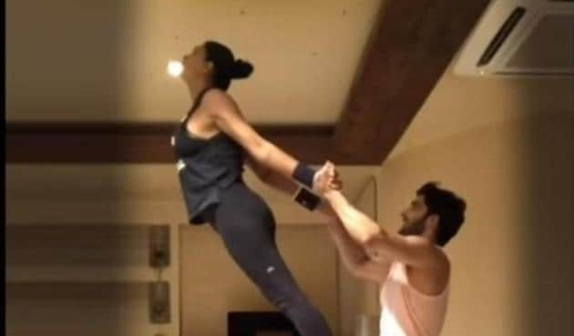 Rohman Shawl balances Sushmita on his thighs during the workout session.