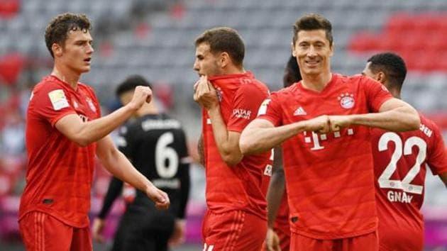 Bayern Munich's Robert Lewandowski celebrates with teammates their goal.(REUTERS)