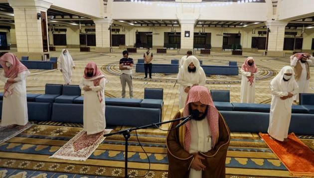 Muslims perform the Al-Fajr prayer inside the Al-Rajhi Mosque while practising social distancing, after the announcement of the easing of lockdown measures amid the coronavirus disease (Covid-19) outbreak, in Riyadh, Saudi Arabia May 31, 2020.(REUTERS)