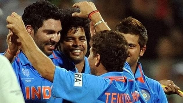 India cricketers Sachin Tendulkar (R, front) and Yuvraj Singh celebrate their victory during the ICC Cricket World Cup final match between India and Sri Lanka at The Wankhede Stadium in Mumbai on April 2, 2011.(AFP)