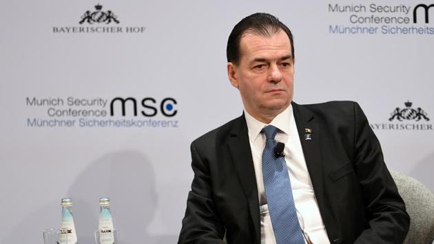 Romania's Prime Minister Ludovic Orban was seen smoking and drinking with other ministers and also did not wear a mask.(REUTERS)