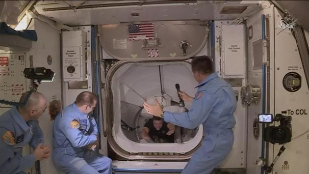 Crew of SpaceX entering the International Space Station.(Associated Press)