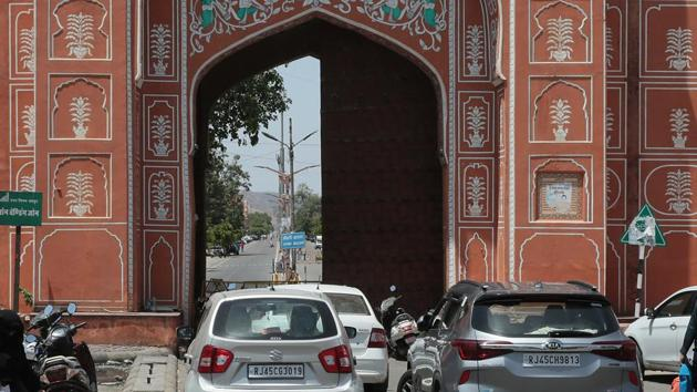 People looking to enter the walled city containment zone have parked their cars opposite Sanganeri Gate, in Jaipur.(Photo by Himanshu Vyas/ Hindustan Times)
