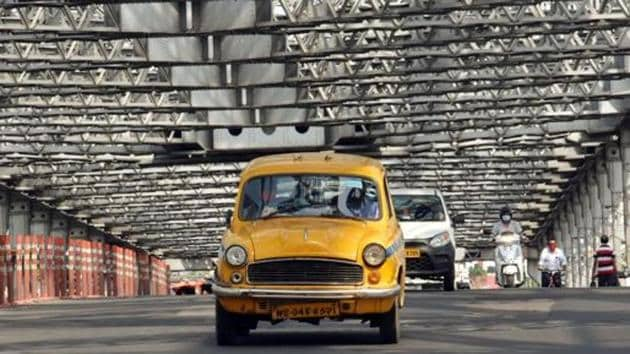Taxis, radio taxis and auto-rickshaws have been allowed to ply with only two passengers in Kolkata and adjoining areas.(ANI PHOTO.)