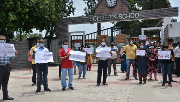 Parents protesting outside St Soldier Divine Public School in Sector 16, Panchkula, on Saturday.(SANT ARORA/HT)
