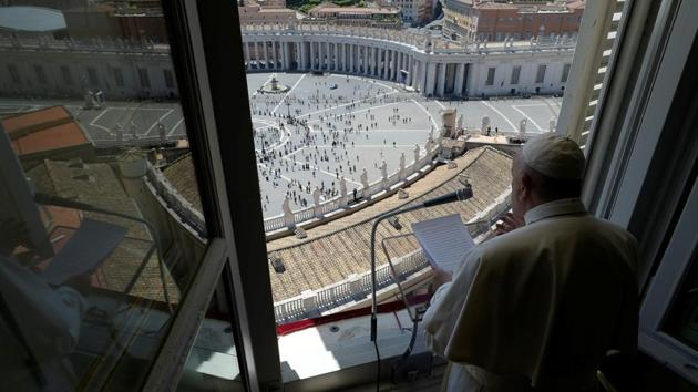 Pope Francis leads the Regina Coeli prayer from his window in the newly reopened St. Peter's Square after months of closure due to an outbreak of the coronavirus disease (Covid-19), at the Vatican, May 31, 2020.(via REUTERS)