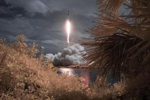 In this photo provided by NASA, a SpaceX Falcon 9 rocket carrying the company's Crew Dragon spacecraft is seen in this false color infrared exposure as it is launched on NASA's SpaceX Demo-2 mission to the International Space Station with NASA astronauts Robert Behnken and Douglas Hurley onboard.(AP)