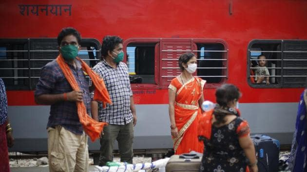 As millions of daily-wage workers who lost their livelihoods in the aftermath of the Covid-19 lockdown travel by Shramik Special trains to their states of domicile, a protocol has been put in place for transporting and handling the workers.(AP Photo)
