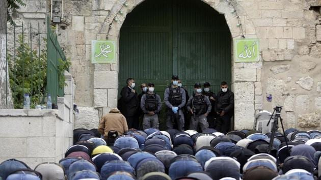 """Hundreds of Muslims chanted """"God is the greatest"""" as they packed into the compound in Jerusalem's walled Old City early on Sunday for dawn prayers.(AP file photo)"""