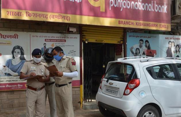 Policemen outside Punjab National Bank at Kishangarh village in Chandigarh on Sunday.(Sant Arora/HT)