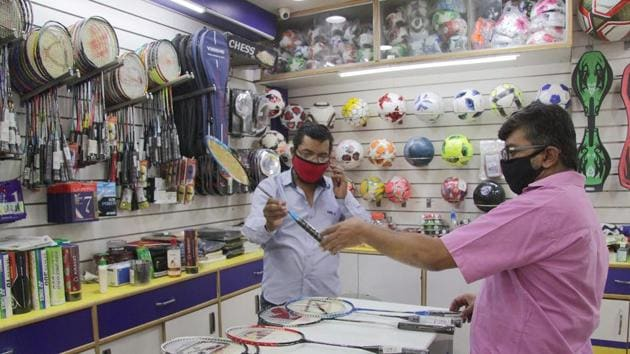 Sports shop open for business at FC road, during the lockdown, in Pune, India, on Saturday, May 30, 2020.(Ravindra Joshi/ HT)