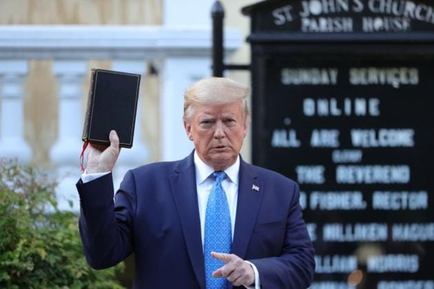 US President Donald Trump holds up a Bible during a photo opportunity in front of St. John's Episcopal Church in the midst of ongoing protests over racial inequality in the wake of the death of George Floyd while in Minneapolis police custody, outside the White House in Washington, US.(REUTERS)