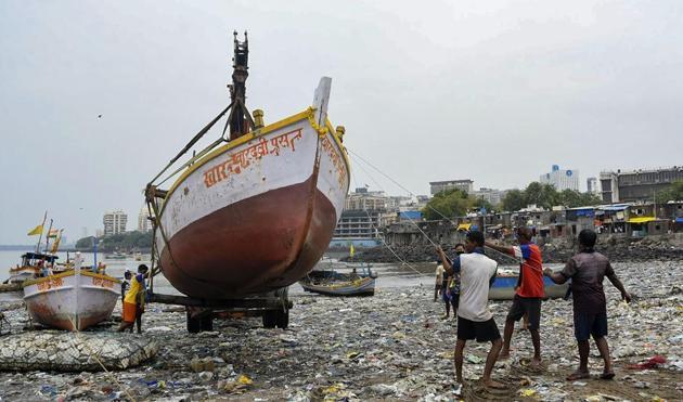 An earthmover carries a boat as fishermen take precautionary measures ahead of Cyclone Nisarga, in Mumbai, June 2(PTI)