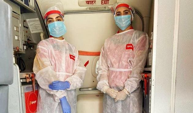 Air hostesses in PPE suits have been compared with characters from sci-fi movies by some recent air travellers, on social media.(PHOTO: TWITTER)