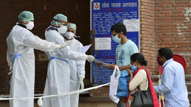 New Delhi: Medics at a government hospital check papers of coronavirus positive patients during ongoing Covid-19 lockdown.(PTI)