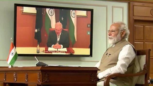 PM Modi and his Australian counterpart Scott Morrison holding a virtual summit on Thursday.(YouTube/Narendra Modi)