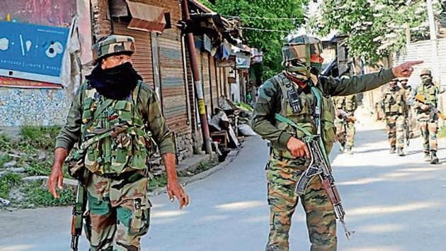 Security personnel cordon off the area after militants fired on a police team in Kulgam on Thursday.