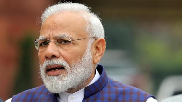 FILE PHOTO: Prime Minister Narendra Modi speaks to the media inside the parliament premises on the first day of the winter session in New Delhi, India, November 18, 2019. REUTERS/Altaf Hussain/File Photo