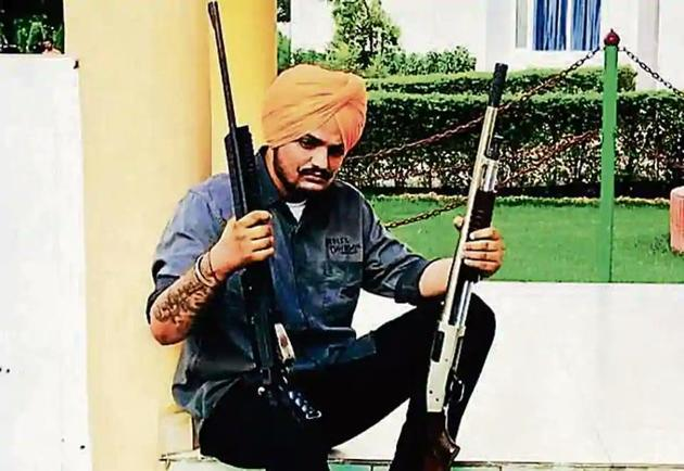 On May 4, Barnala police had booked Moose Wala and eight others in for violating curfew after a video of him firing an official assault rifle went viral on social media. Seven cops, including a DSP, have been suspended in the matter. Later, Sangrur police booked Moose Wala, his friends and some cops after another video of the singer surfaced where he was seen firing from a private pistol at Ladda Kothi shooting range.(HT PHOTO)
