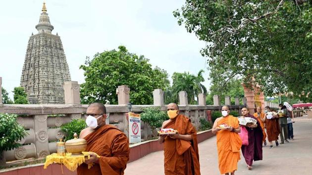 Bodh Gaya: Resident monks of Bodh Gaya temple on their way to offer special prayers to mitigate the spread of coronavirus, in Bodh Gaya, Friday, June 5, 2020.(PTI)