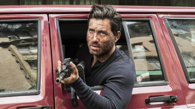The Last Days Of American Crime movie review: Edgar Ramirez as Graham Bricke in a still from the new Netflix film.(Marcos Cruz/Netflix)