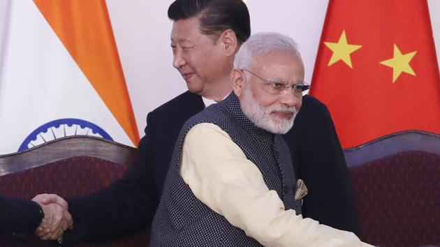 Prime Minister Narendra Modi, front and Chinese President Xi Jinping at BRICS summit.(HT Archives)