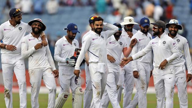 India's cricket team captain Virat Kohli, center, celebrates with teammates after winning the second cricket test match.(AP)