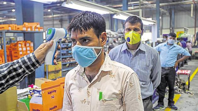 An acute shortage of workers has left industries struggling to pick up pace after government allowed resumption of business.(AFP Photo)