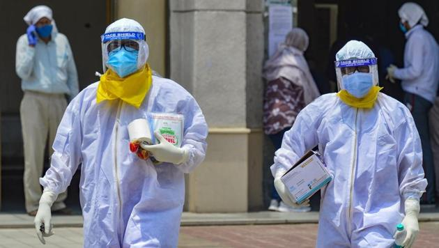 Medics take samples of suspected Covid-19 patients for lab test at a government hospital, during the ongoing nationwide lockdown to curb spread of coronavirus, in New Delhi, Tuesday, June 9, 2020.(PTI photo)