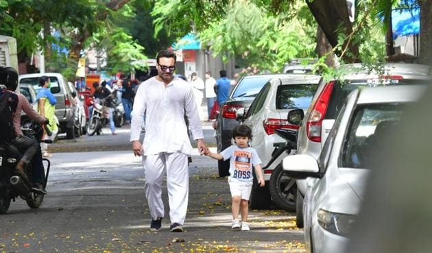 As the restrictions of the two-month nationwide lockdown are slowly relaxed, Bollywood celebrities stepped out of their houses for a breath of fresh air. Saif Ali Khan was spotted taking a walk with son Taimur. (Varinder Chawla)