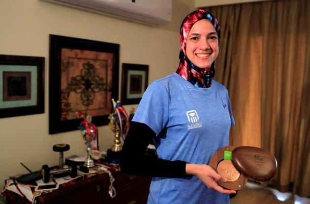 Hedaya Malak Wahba, Egyptian Taekwondo practitioner poses for a photograph with her 2016 Rio Olympics bronze medal and trophies at her home as she trains for the postponed Tokyo Olympic Games amid the spread of the coronavirus disease (COVID-19), in Cairo, Egypt June 4, 2020. Picture taken June 4, 2020. REUTERS/Amr Abdallah Dalsh (REUTERS)